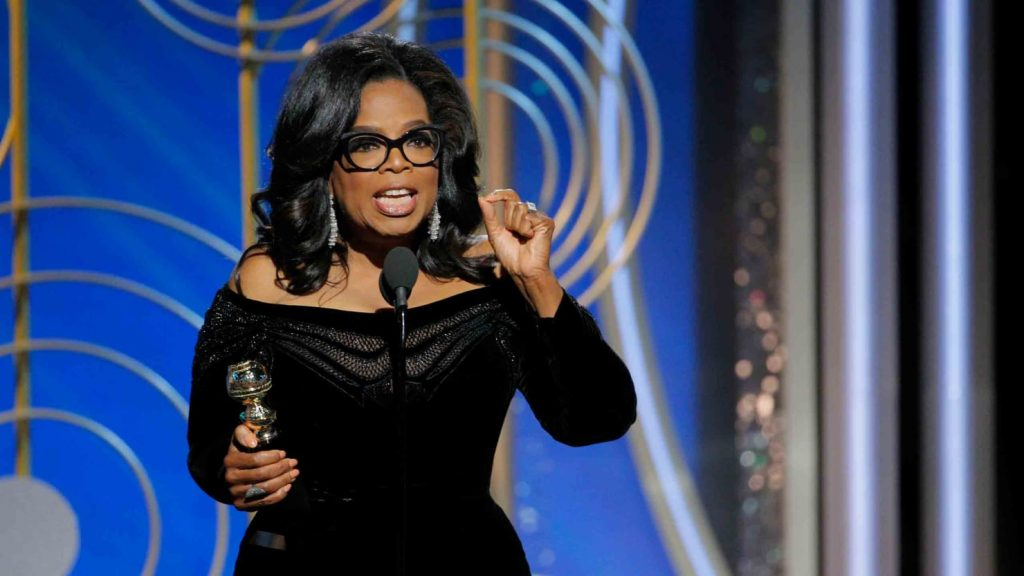 Oprah Winfrey accepts the Cecil B. DeMille Award for lifetime achievement at the Golden Globes in 2018